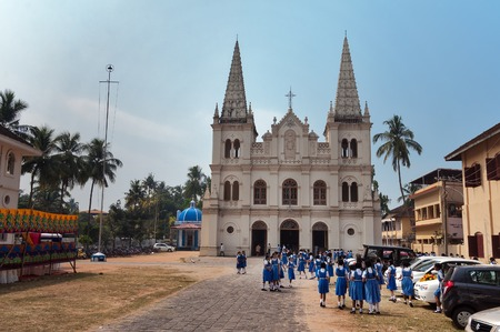 young schoolgirl: Fort Kochi, India - Jan 7, 2015: Indian young schoolgirls near the Santa Cruz basilica colonial Church in Fort Kochi. Fort Kochi is a region in the city of Kochi in the state of Kerala, India.
