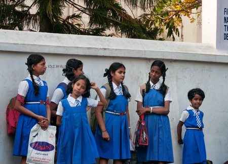 kochi: Fort Kochi, India - Jan 7, 2015: Indian young schoolgirls on the street in Fort Kochi. Fort Kochi is a region in the city of Kochi in the state of Kerala, India.