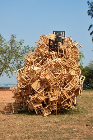 carriers: Fort Kochi, India - Jan 7, 2015: Installation of Carriers of Democracy from wood, metal, rubher tyres, rope, jute. Mansoor Ali