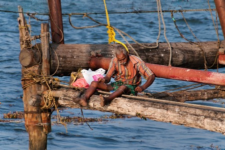 chinese fishing nets: Fort Kochi, India - Jan 6, 2015: Unidentified Indian Fisherman  on Chinese Fishing nets in Fort Kochi. Kerala. India