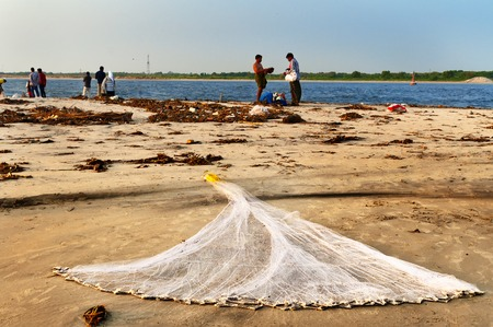 kochi: Fort Kochi, India - Jan 6, 2015: Fishing net on the beach of Fort Kochi. Kerala. Fort Kochi is a region in the city of Kochi in the state of Kerala, India.
