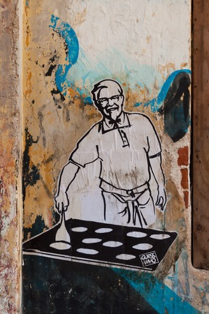 satirical: Fort Kochi, India - Jan 7, 2015: Graffiti art on the wall in Fort Kochi. This satirical street art by the GuessWho executed in a stencilling technique Editorial