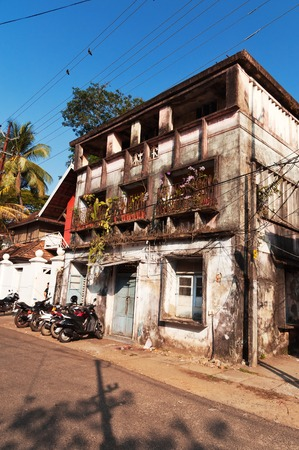kochi: Fort Kochi, India - Jan 7, 2015: Old house on the street in Fort Kochi. Fort Kochi is a region in the city of Kochi in the state of Kerala, India. Editorial