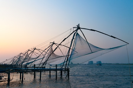 Chinese Fishing nets at sunset. Fort Kochi. Kerala. India Stock Photo