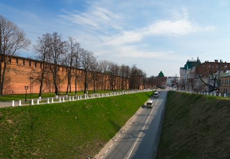 erection: Nizhny Novgorod, Russia - May 2, 2015: Street along the Kremlin in Nizhny Novgorod. Kremlin is a historical centre of Nizhny Novgorod. Nizhny Novgorod Kremlin erection in its present appearance was started in 1500 and lasted for 15 years