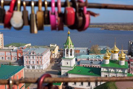 precursor: View of Church of the Nativity of John the Precursor through the bridge with love locks in Nizhny Novgorod. Russia Editorial