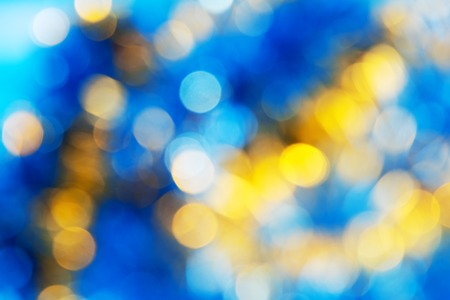 Blue Yellow White bokeh. Christmas background texture