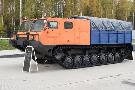 tracked: Nizhny Tagil, Russia - Sept 11, 2015: Special machine on the basis - Multipurpose tracked chassis MGSH521m1 on 10 Anniversary International Exhibition of Arms, Military Equipment and Ammunition