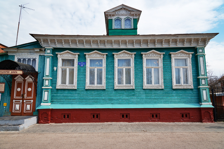 goodness: Gorodets,  Russia - May 3, 2015: The Museum of goodness, old blue wooden house with white carved patterns. Gorodets is the oldest city in the Nizhny Novgorod region, the center of folk art and museum city. Editorial