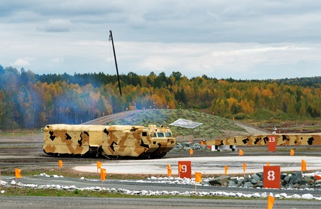 tracked: Nizhny Tagil, Russia - Sept 11, 2015: Two-section tracked carrier DT-10PM at firing range. Display of fighting opportunities of arms and military equipment of land forces on 10 Russia Arms Expo
