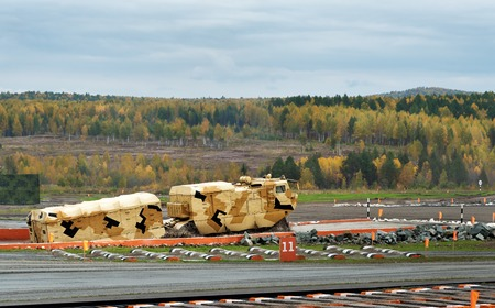 tracked: Nizhny Tagil, Russia - Sept 11, 2015: Two-section tracked carrier DT-10PM on obstacle ford 1.8 m deep at firing range. Display of fighting opportunities of arms and military equipment of land forces on 10 Russia Arms Expo Editorial