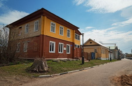 two story: Gorodets,  Russia - May 3, 2015: Old wooden two story house. Gorodets is the oldest city in the Nizhny Novgorod region, the center of folk art and museum city.