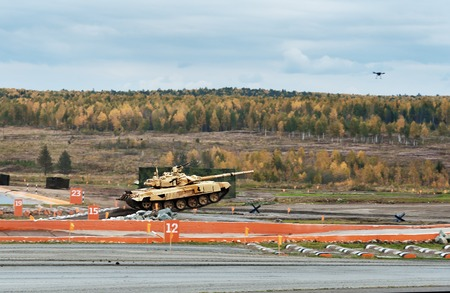 springboard: Nizhny Tagil, Russia - Sept 11, 2015: Modernized Main battle tank T-90S on obstacle springboard at firing range. Display of fighting opportunities of arms and military equipment of land forces on 10 Russia Arms Expo Editorial