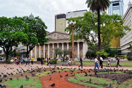 origins: Buenos Aires, Argentina- Jan 19, 2011: View of Metropolitan Cathedral from Plaza de Mayo square. The Cathedral of Buenos Aires was rebuilt several times since its  origins in the 16th century