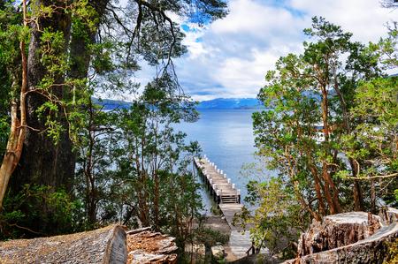 lake beach: Wooden pier in Los Arrayanes National Park. San Carlos de Bariloche. Argentina