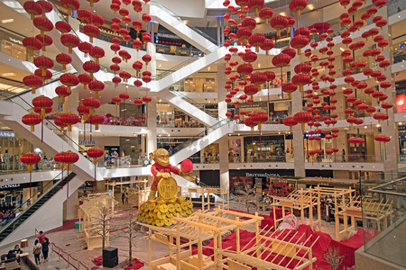 bukit: Kuala Lumpur, Malaysia - Jan 07, 2016: Pavilion shopping mall interior. Work in process of decoration the Chinese New Year of Red Monkey Editorial