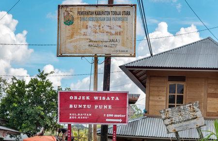 pune: Rantepao, Indonesia - Dec 07, 2015: Street signs of Buntu Pune village in Tana Toraja, Sulawesi. Buntu Pune village has two fine tongkonan houses and six rice barns built around 1880