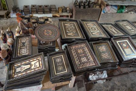 toraja: Rantepao, Indonesia - Dec 07, 2015: Toraja carved wooden Trays in souvenir shop. Tana Toraja, Sulawesi