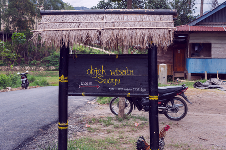 toraja: Tana Toraja, Indonesia - Dec 08, 2015: Street signs of Suaya. The traditional cliffs old burial site of the royal family of Sangalla. South Sulawesi
