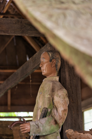 royal family: Tana Toraja, Indonesia - Dec 08, 2015: Old wooden statue of Tau Tau are representatives of the deceased and guard the tombs. Suaya is cliffs old burial site of the royal family of Sangalla in Tana Toraja. South Sulawesi, Indonesia