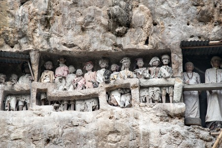 deceased: Wooden statues of Tau Tau are representatives of the deceased and guard the tombs. Suaya is cliffs old burial site of the royal family of Sangalla in Tana Toraja. South Sulawesi, Indonesia