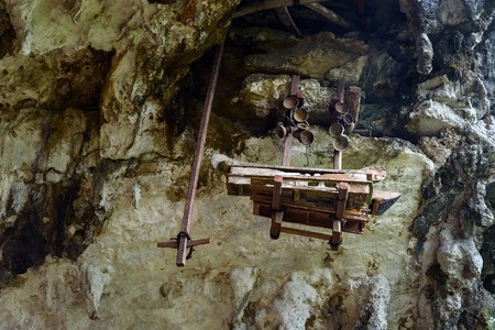 coffins: Collection of very old coffins. Londa is cliffs and cave old burial site in Tana Toraja. South Sulawesi, Indonesia