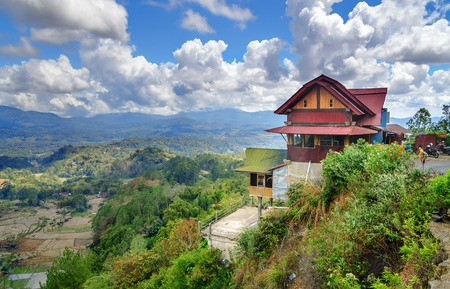 Coffee house on the road with view of green rice field terraces in Tana Toraja. South Sulawesi, Indonesia