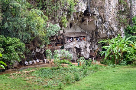 coffins: Londa is cliffs and cave old burial site in Tana Toraja. Galleries of tau-tau on balcony guard the graves. Inside theres a collection of coffins. South Sulawesi, Indonesia