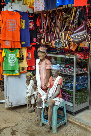 toraja: Tana Toraja, Indonesia - Dec 08, 2015: Wooden statues of Tau Tau in the market of Tana Toraja. South Sulawesi, Indonesia