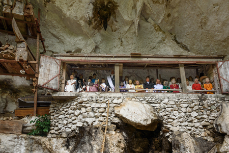 coffins: Tana Toraja, Indonesia - Dec 08, 2015: Galleries of tau-tau on balcony guard the graves. Londa is cliffs and cave old burial site in Tana Toraja. Inside theres a collection of coffins. South Sulawesi
