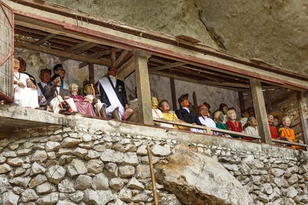 coffins: Tana Toraja, Indonesia - Dec 09, 2015: Galleries of tau-tau on balcony guard the graves. Londa is cliffs and cave old burial site in Tana Toraja. Inside theres a collection of coffins. South Sulawesi