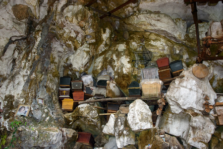 coffins: Tana Toraja, Indonesia - Dec 09, 2015: Collection of coffins. Londa is cliffs and cave old burial site in Tana Toraja. South Sulawesi