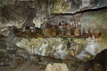 royal family: Wooden statues of Tau Tau and coffins in Tampang Allo burial cave of the royal family.  Tana Toraja. South Sulawesi. Indonesia Stock Photo