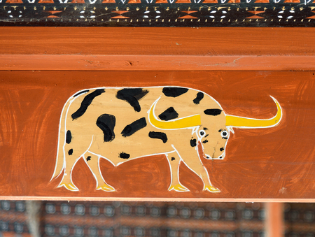 wood carvings: Rantepao, Indonesia - Dec 09, 2015: Toraja traditional house wood carvings and paitings with buffalo Editorial