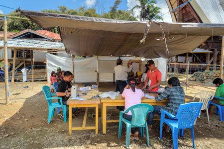 toraja: Tana Toraja, Indonesia - Dec 09, 2015: Legislative elections held in Lempo village. unidentified Indonesian people count voices.  South Sulawesi Editorial