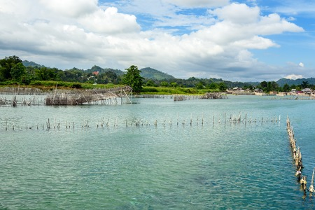 hatchery: Fish farm and hatchery on Poso River near Tentena. Central Sulawesi. Indonesia Stock Photo