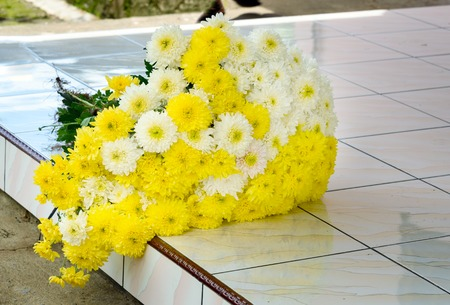 doorstep: Bouquet of chrysanthemums on the doorstep. Tomohon is City of Flowers. North Sulawesi. Indonesia