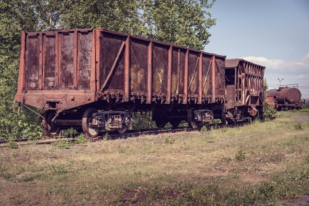 hopper: Old open wagon and hopper car. Old industrial railway cars on on Mining and metallurgical plant