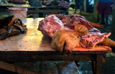 terribly: Head and meat of pig on Tomohon Traditional Market. North Sulawesi. Indonesia Stock Photo