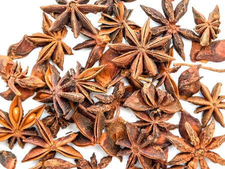 badiane: Top view of Anise stars on white background. Texture Stock Photo