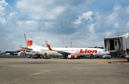 air plane: Jakarta, Indonesia - Dec 28, 2015: Lion Air airplane parked at Soekarno-Hatta International Airport. Lion Air is an Indonesian low-cost carrier