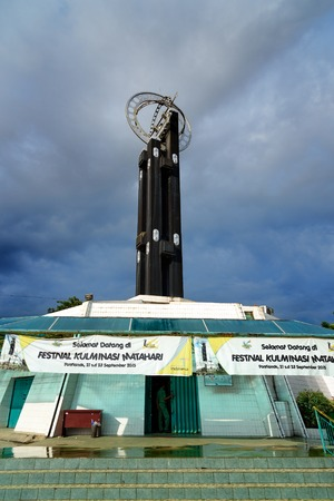 equator: Pontianak, Indonesia - Dec 28, 2015: Equatorial Monument is located on the equator. Its grand opening on 1991