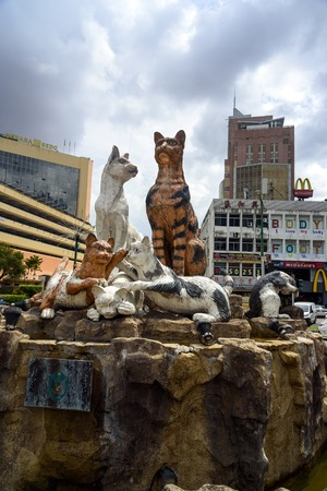 Kuching, Malaysia - Dec 29, 2015: Cats monument at center of Kuching. Sarawak. Borneo. Kuching means cat in Malay