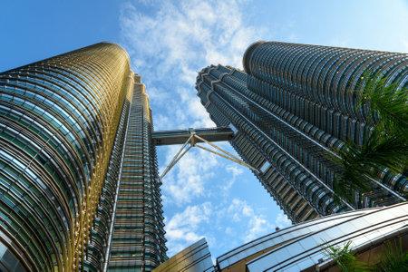 Kuala Lumpur, Malaysia -January 7, 2016: View of Petronas Twin Towers in sunlight. The skyscraper height is 451.9 m, 88 floors