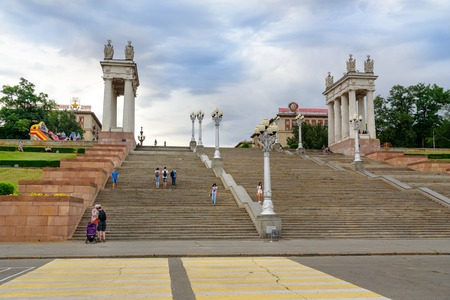 river banks: Volgograd, Russia - August 31, 2016: Central embankment. View staircase and the architectural gates. Volga river banks