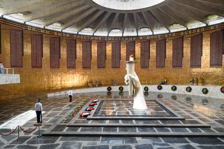 Volgograd, Russia - Aug 31, 2016: Hall of Military Glory. In centre of hall is sculpture of hand holding torch with Eternal Fire. Eternal Fire is guarded by soldiers. Memorial complex Mamayev Kurgan