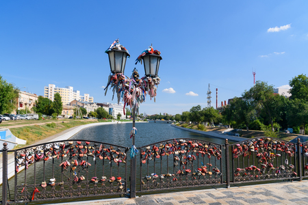 bunch of hearts: Astrakhan, Russia - September 05, 2016: Love Bridge with a lot of colored ribbons and locks. Symbol of the wedding