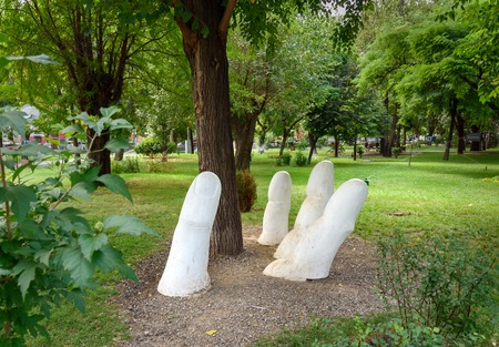 Astrakhan, Russia - September 06, 2016: Sculpture fingers in Park Fraternal Garden Editorial