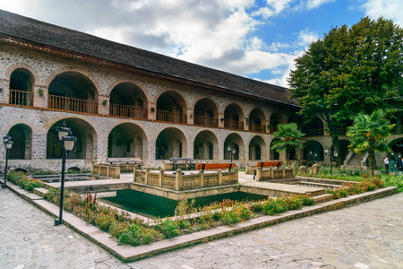 upper floor: Sheki, Azerbaijan - September 13, 2016: View of the inner courtyard of Upper caravanserai is a historical monument in Sheki 18th-19th centuries. It was used by merchants to store their goods in cellars, who traded on the first floor, and lived on the seco