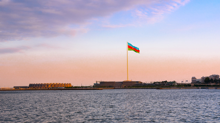 View of National Flag Square in Baku on sunset. Azerbaijan. Flag measuring 70 by 35 metres flies on pole 162 m high